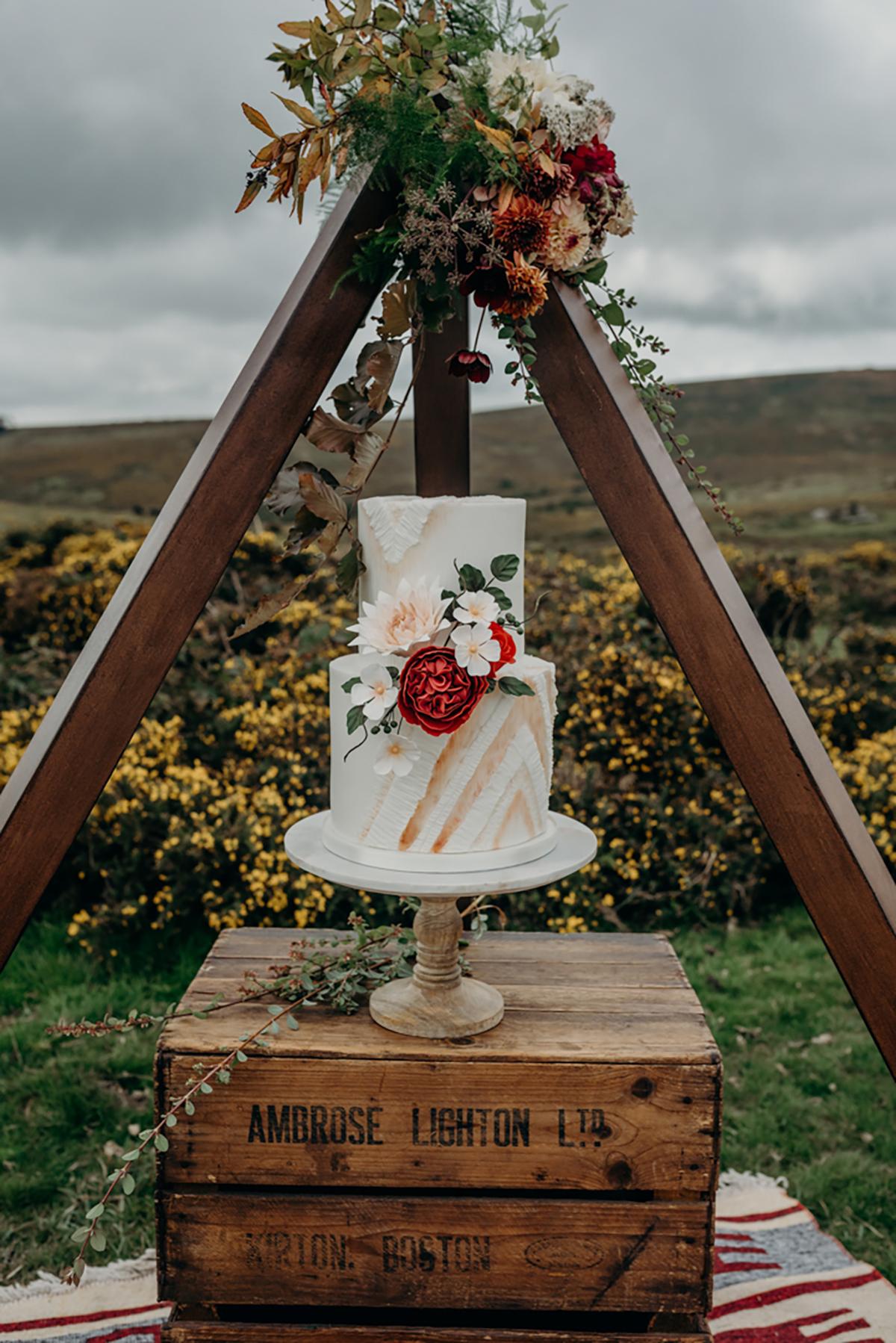 wedding cake styled in wooden tipt boho festival wedding inspiration