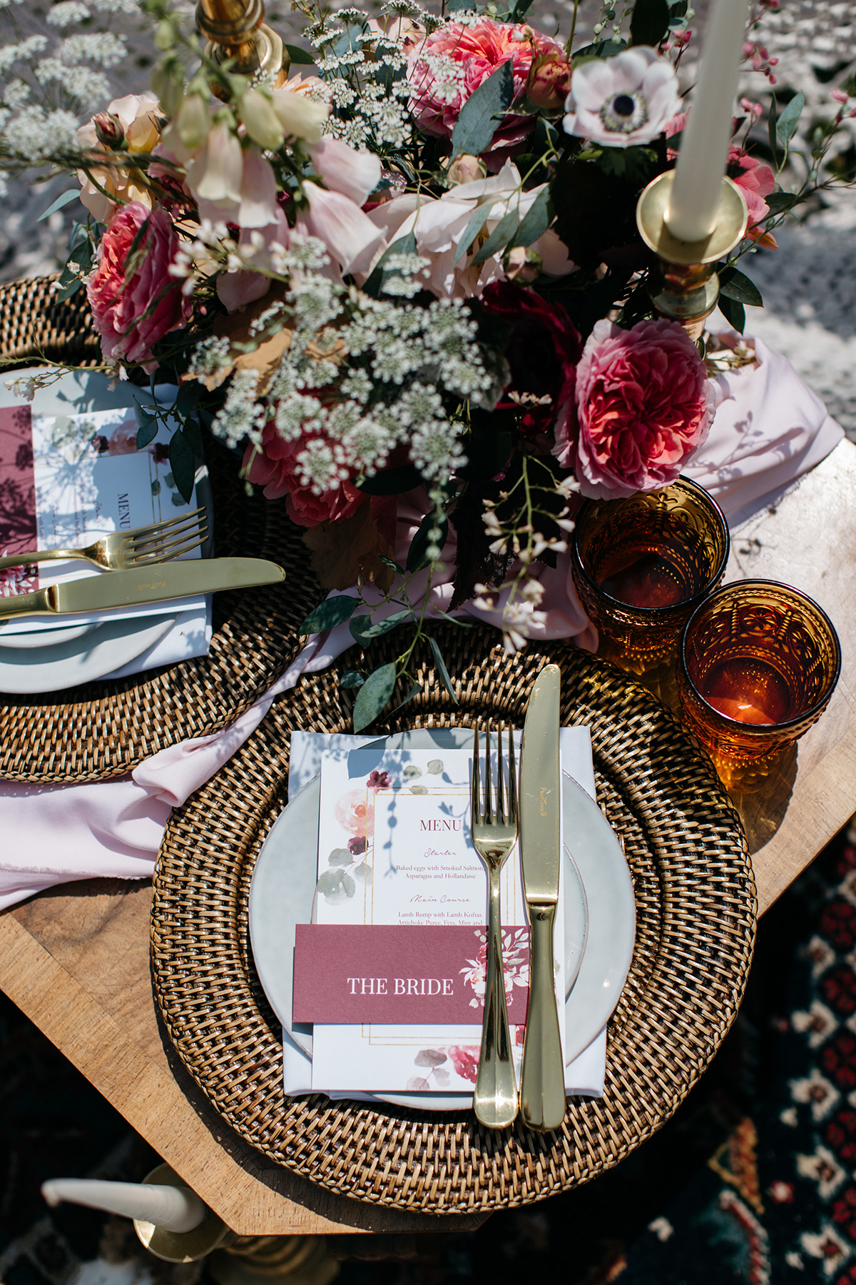 modern elopement tablescape place setting styled with rattan charger plates and gold cutlery