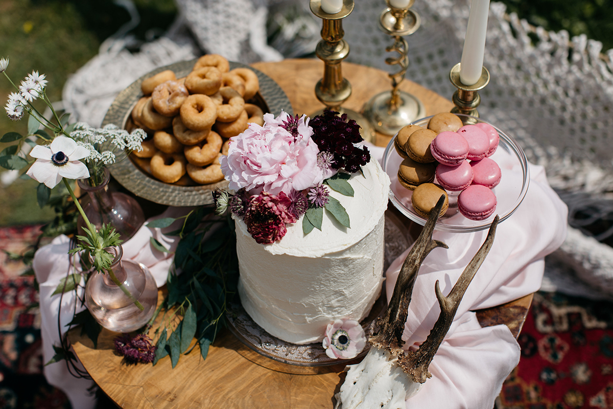 modern elopement wedding inspiration mini dessert table with doughnuts and macaroons