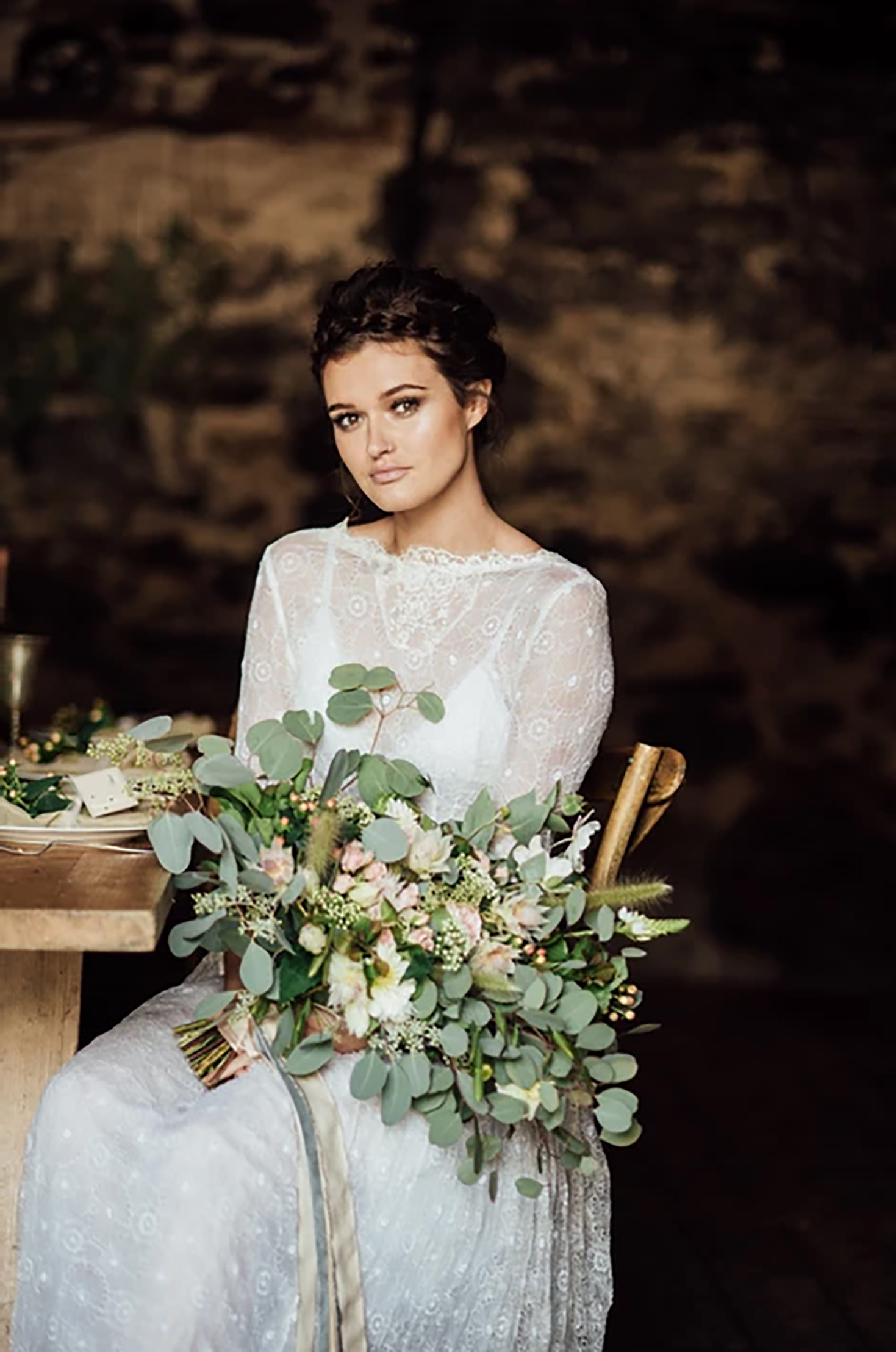Bride holding green and white bouquet styled micro wedding devon
