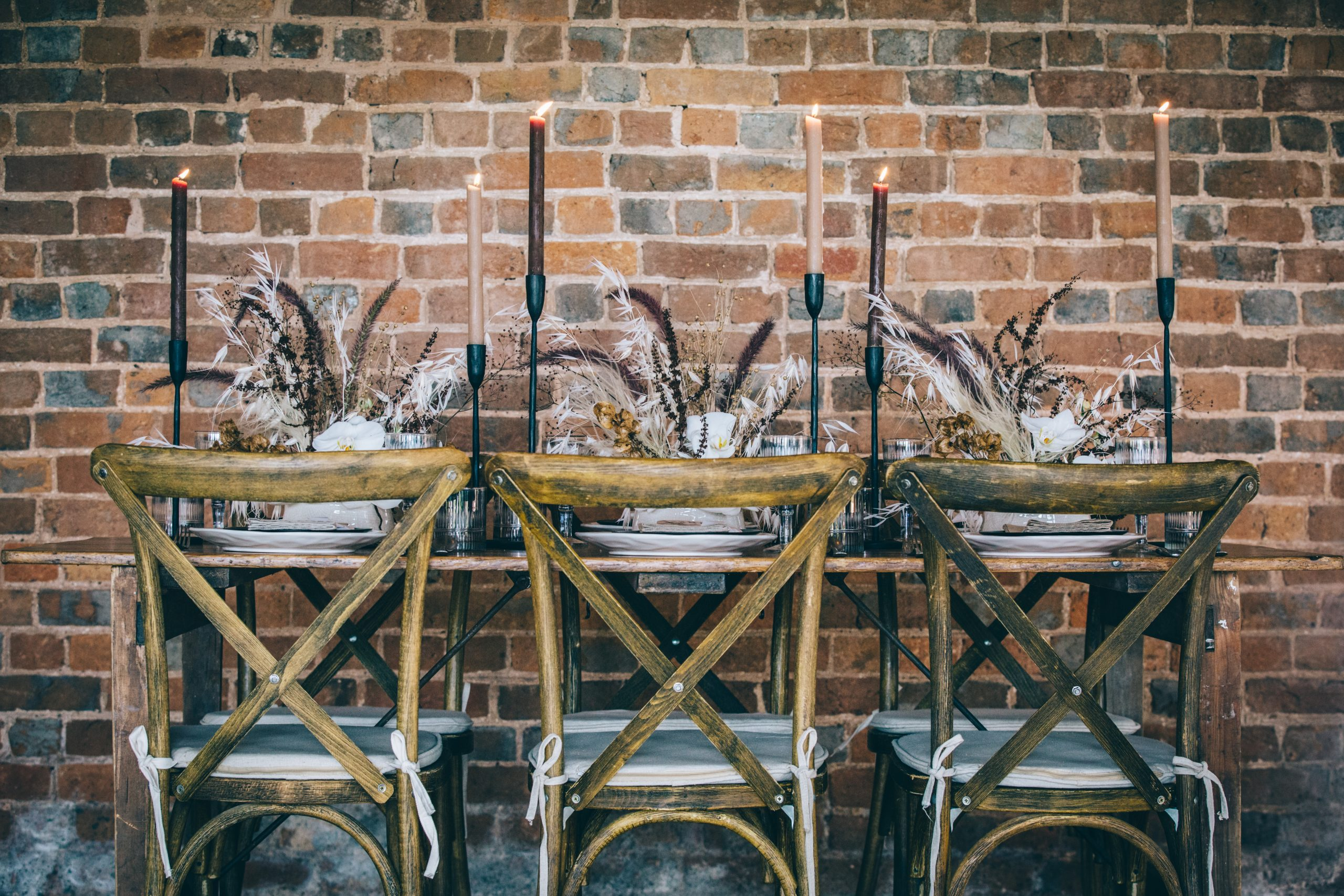 boho luxe styled wedding shoot tablescape with fried grasses and black candlesticks