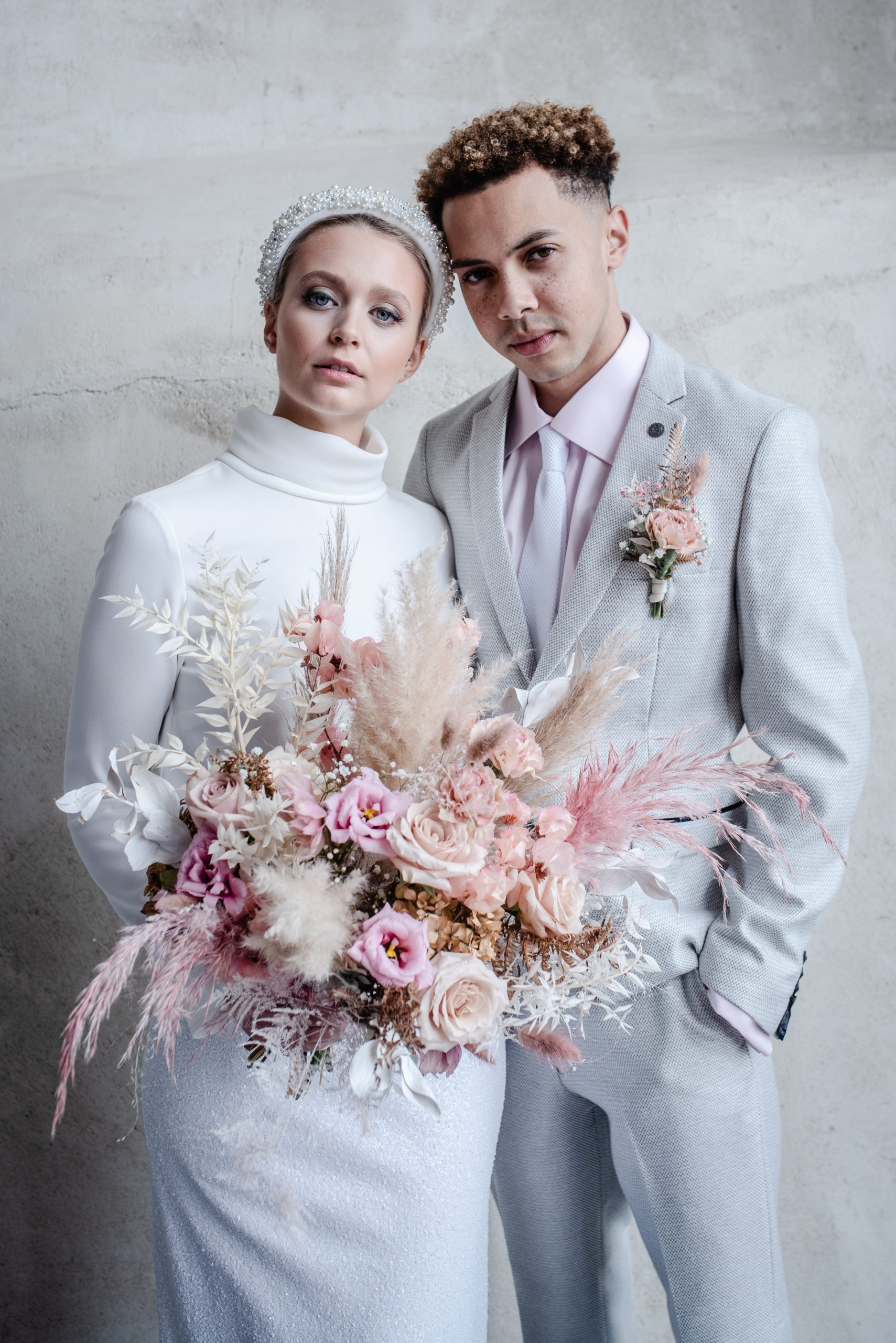 bride and groom pastel styled shoot large dried flower bouquet