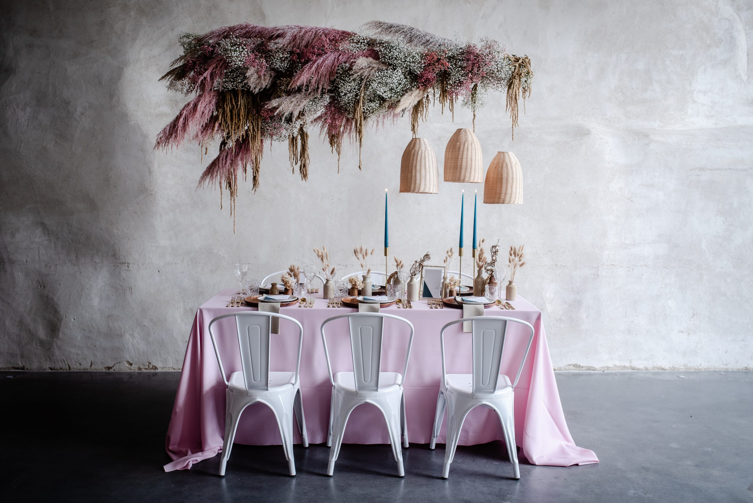 wedding tablescape dried flowers rattan shades pastel pink linen teal candles